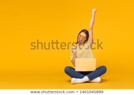 casual woman sits with laptop victory stock photo © feedough