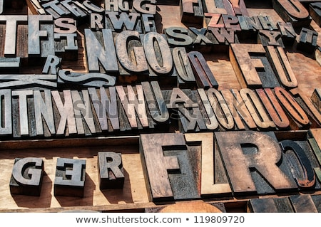 A bunch of old vintage wooden block printing press letters. stock photo © shanemaritch