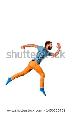 Jonge man toevallig kleding hoogspringen studio Stockfoto © feedough