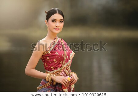 Beauty Portrait. Beautiful girl in red dress and fashionable hai Stock photo © fotoatelie