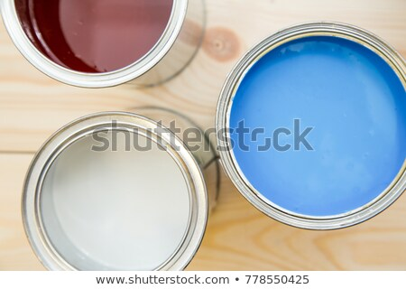 Stock photo: Paint roller and color tin can on wooden background