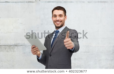 happy hispanic young business man with thumbs up gesture stock photo © pxhidalgo