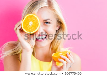 beautiful woman holding half of grapefruit Stock photo © chesterf