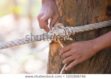 Stock photo: Man Hands Tied With String