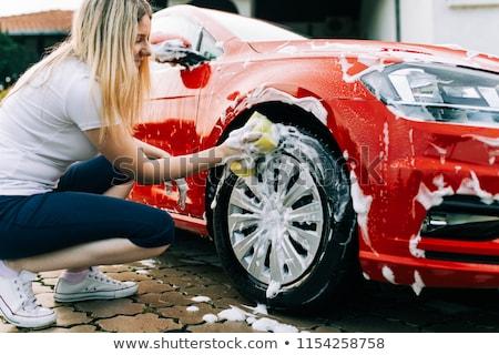 young woman washing car stock photo © aikon