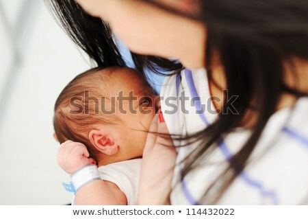 mother is giving her baby breastfeeding stock photo © dnf-style