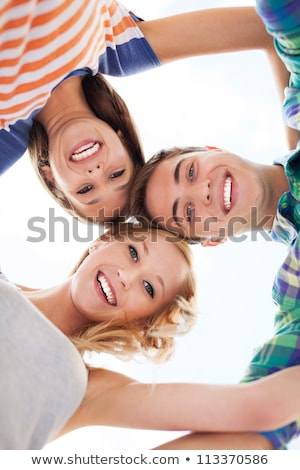 group of teenagers in huddle Stock photo © ambro