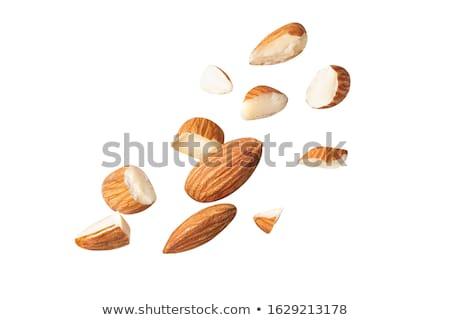 mandulák · fából · készült · tányér · étel · gyümölcs · fehér - stock fotó © yelenayemchuk