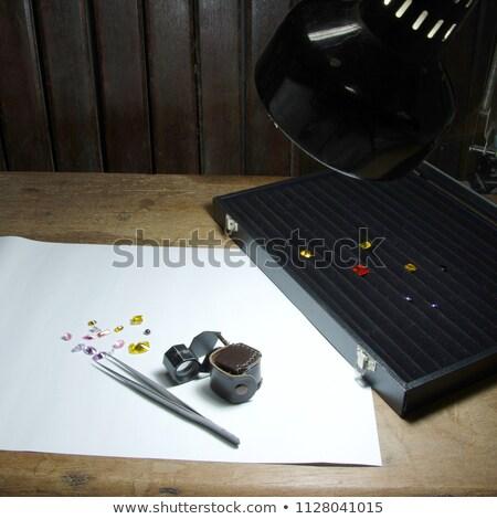 diamonds in a working tray and tweezers stock photo © RedDaxLuma