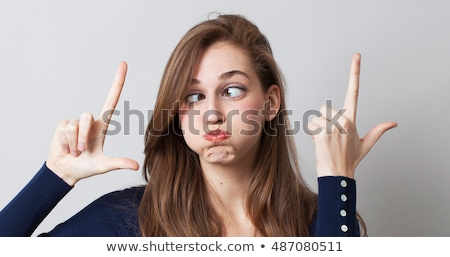 Cross eyed funny face Stock photo © phakimata