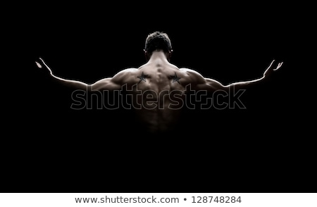 rear view of healthy muscular young man silhouette stock photo © deandrobot