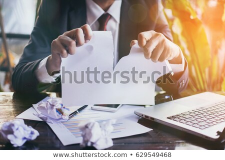 Business man in suit throwing a folder Stock photo © deandrobot