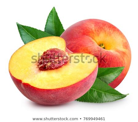 Um nectarina pêssego metade beber frutas Foto stock © pedromonteiro