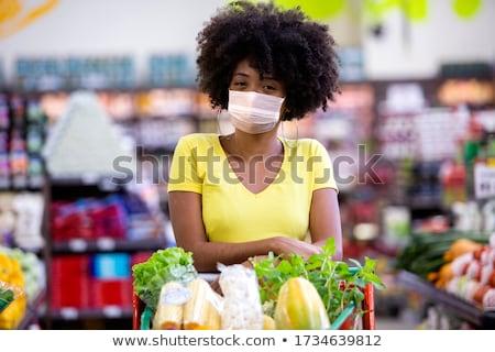 jóvenes · mujer · bolsa · de · la · compra - foto stock © hasloo