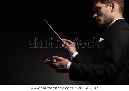 Junger Mann Orchester Seitenansicht Business Mode Hintergrund Stock foto © feedough
