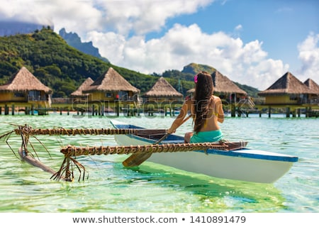 Woman with outrigger. stock photo © iofoto