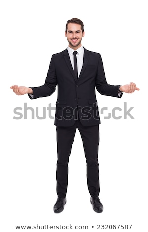 Businessman with open hands looking at the camera Stock photo © wavebreak_media