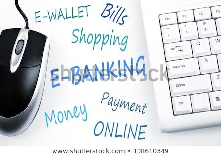 E-banking word scheme and computer keyboard Stock photo © fuzzbones0