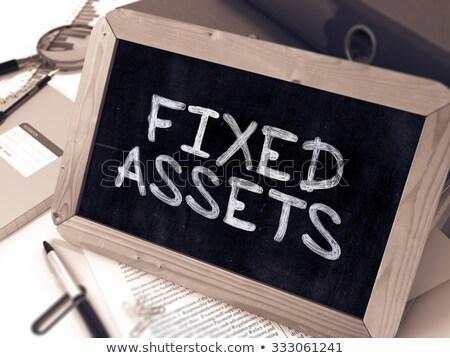 Fixed Assets Handwritten on Chalkboard. Stock photo © tashatuvango