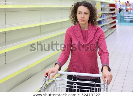 young woman with  cart in shop with empty shelves Stock photo © Paha_L
