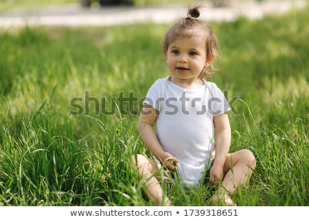closeup portrait of drinking girl in grass Stock photo © Paha_L