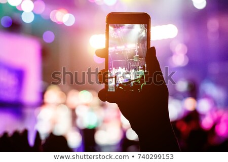 Fans taking pictures of music band performing live on stage Stock photo © stevanovicigor