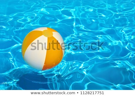 The boy floats in inflatable pool with multi-coloured balls. Stock photo © Paha_L