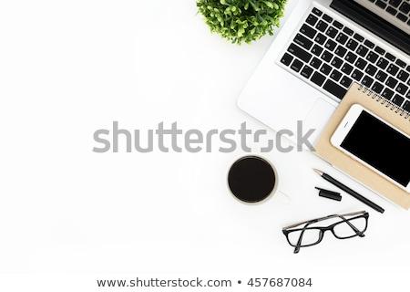 Fekete notebook fából készült irodai asztal felső kilátás Stock fotó © stevanovicigor