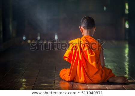 Buddhist novices inside temple Stock photo © szefei