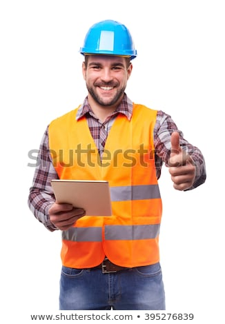 Young engineering with orange helmet working on a tablet pc Stock photo © razvanphotos