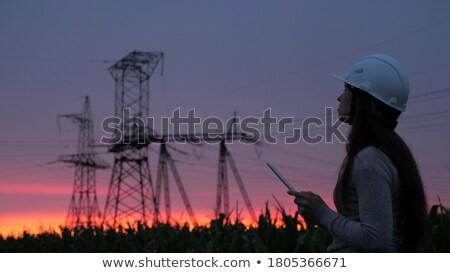 elektromos · naplemente · nap · horizont · felhő · föld - stock fotó © marcrossmann