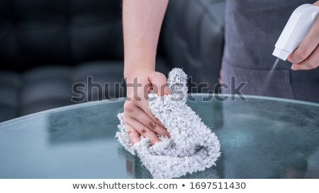 close up of hand cleaning table surface with cloth Stock photo © dolgachov