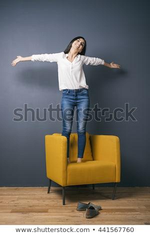 Güzel kız ayakta sandalye deri ofis koltuğu açık Stok fotoğraf © FAphoto