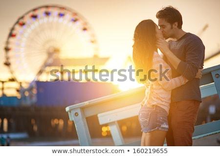 mosolyog · vonzó · lány · piros · pöttyös · ruha · park - stock fotó © artfotodima