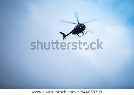 вертолета небе закат лет синий силуэта Сток-фото © konradbak