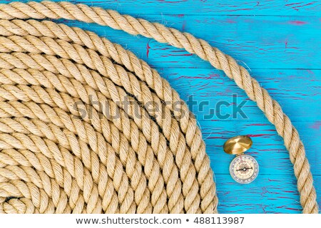 Carefully wound rope with compass over blue Stock photo © ozgur