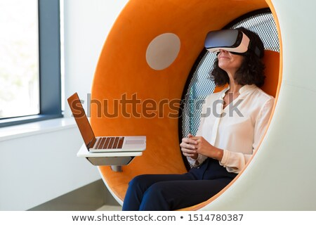 Woman with virtual reality glasses in chair simulator Stock photo © vectorikart