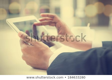 close up of hands with tablet pc and coffee stock photo © dolgachov