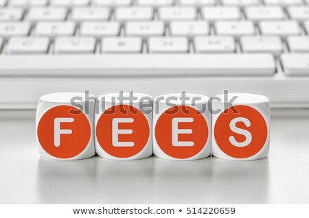Letter dice in front of a keyboard - Fees Stock photo © Zerbor