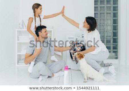 terhes · nő · tart · kicsi · cipők · boldog · otthon - stock fotó © iko