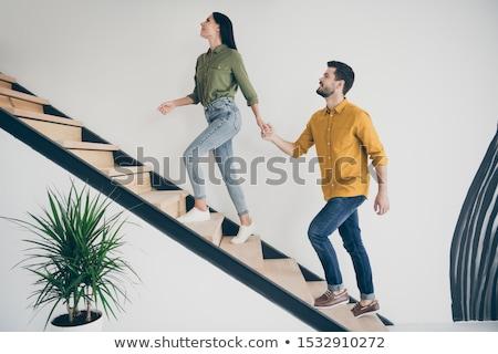 kadın · merdiven · eller · tshirt · çorap - stok fotoğraf © dash