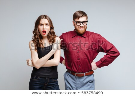 shocked male nerd in funny eyeglasses stock photo © deandrobot