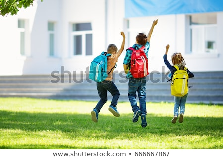 child running and jumping on books Stock photo © choreograph