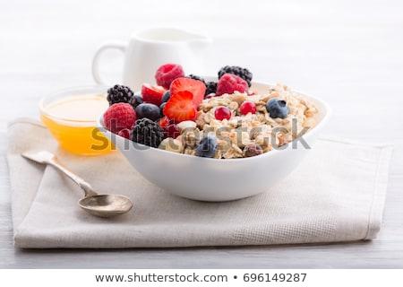 Oatmeal porridge with fresh berries, oats with blueberry and raspberry Stock photo © yelenayemchuk