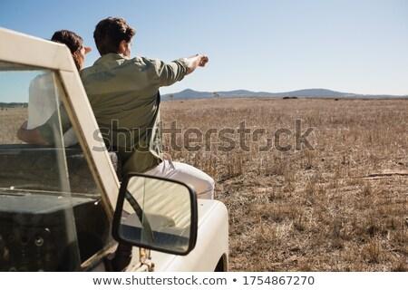 Widok z tyłu człowiek kobieta drogowego pojazd Zdjęcia stock © wavebreak_media