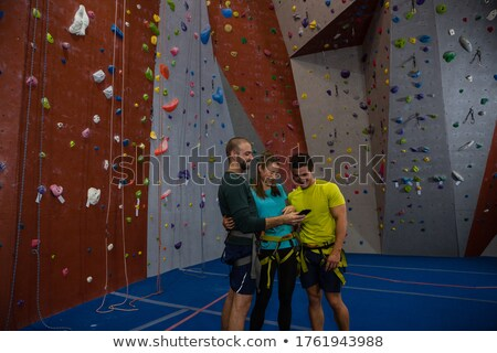 Athletes and trainer climbing wall in gym Stock photo © wavebreak_media