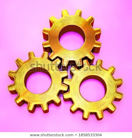 Machinery Production on the Golden Metallic Cogwheels. 3D. Stock photo © tashatuvango