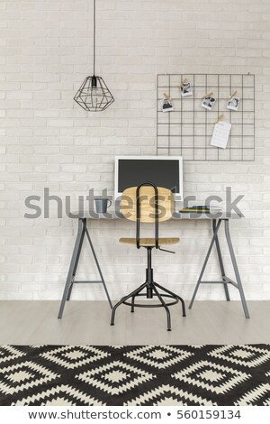 freelance on white brick wall stock photo © tashatuvango