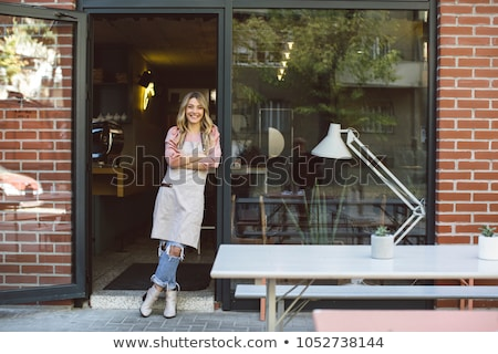 Woman standing in front of a cafe Stock photo © IS2