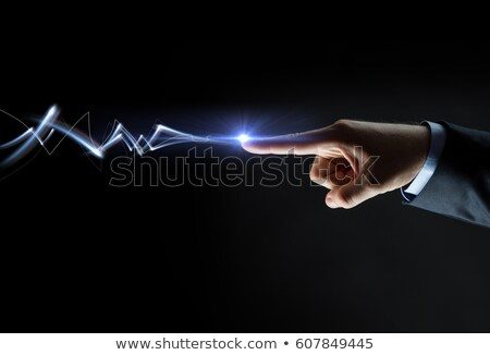 businessman finger connecting to lightning Stock photo © dolgachov